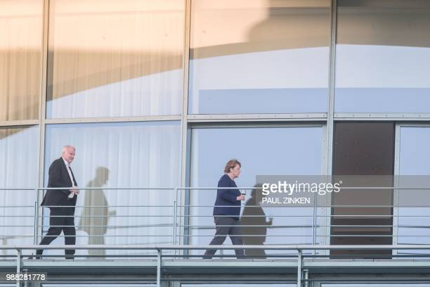 German Chancellor Angela German Chancellor and leader of the Christian Democratic Union Angela Merkel walks in front of German Interior Minister and...
