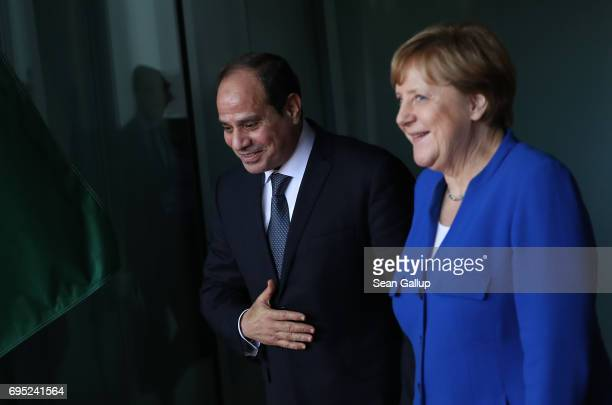 German Chancellor Angela Merkel accompanies Egyptian President Abd El-Fattah El-Sisi upon his departure following talks at the Chancellery on June...