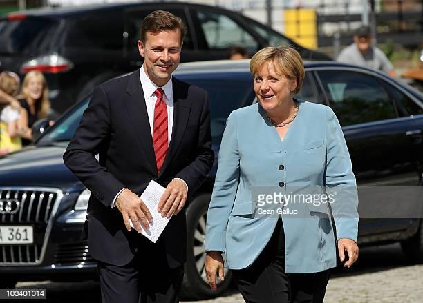 German Chancellor Angela Merkel accompanies new German government spokesman Steffen Seibert to the Federal Press Office for Seibert's official...