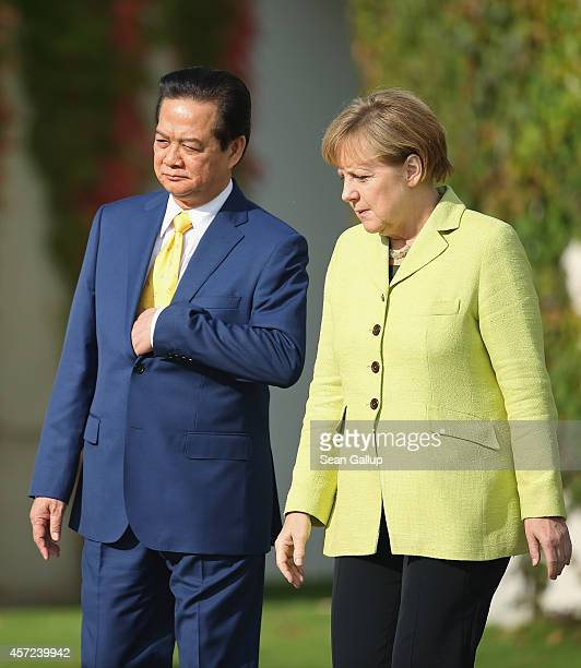German Chancellor Angela Merkel accompanies Vietnamese Prime Minister Nguyen Tan Dung upon his arrival for talks at the Chancellery on October 15...