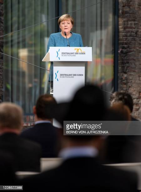 German Chancellor Angela Merkel addresses a ceremony marking the 70th anniversary of the Central Council of Jews in Germany at the New Synagogue in...