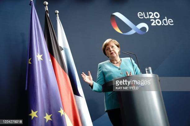 German Chancellor Angela Merkel addresses a joint press conference with EU chief Ursula von der Leyen, joining via video link, at the Chancellery in...
