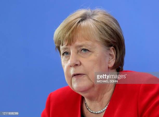 German Chancellor Angela Merkel addresses a press conference at the Chancellery in Berlin on May 6, 2020 after holding a video conference with the...
