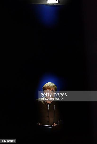 German Chancellor Angela Merkel addresses a press conference at the Chancellery in Berlin on December 23 2016 after Tunisian Anis Amri the suspected...