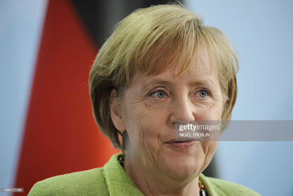 German Chancellor Angela Merkel addresses a press conference with British Prime Minister David Cameron (not pictured) at the Chancellery in Berlin on May 21, 2010. Cameron is on his first visit to Germany since becoming prime minister.