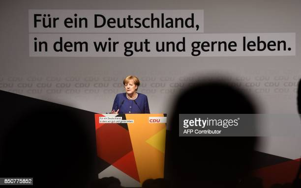 German Chancellor Angela Merkel addresses an election campaign rally of the Christian Democratic Union in Neuss western Germany on September 21...