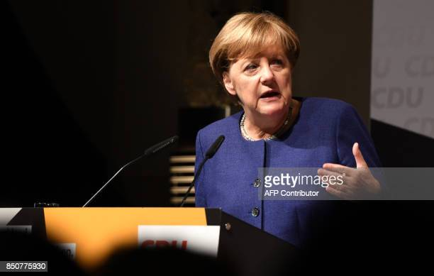 German Chancellor Angela Merkel addresses an election campaign rally of the Christian Democratic Union in Neuss, western Germany on September 21...