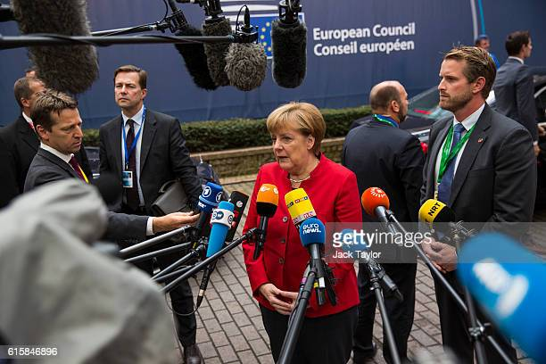 German Chancellor Angela Merkel addresses assembled media as she arrives at the Council of the European Union on the first day of a two day summit on...