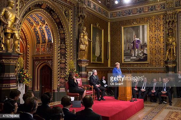 German Chancellor Angela Merkel addresses both Houses of Parliament in the Royal Gallery of the Palace of Westminster on February 27 2014 in London...