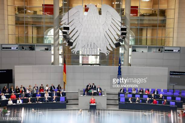 German Chancellor Angela Merkel addresses delegates during a session at the Bundestag on March 21 2019 in Berlin ahead of a EU summit largely devoted...