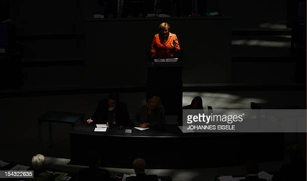 German Chancellor Angela Merkel addresses deputies at the lower house of parliament Bundestag on October 18 2012 in Berlin to outline Germany's...