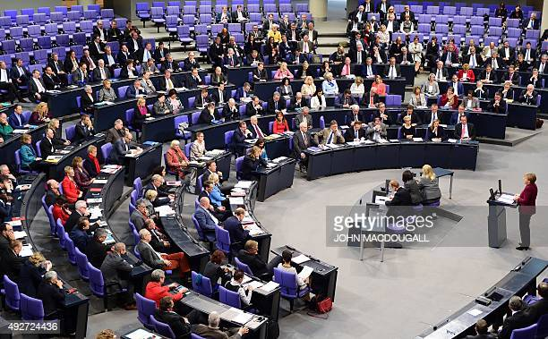 German Chancellor Angela Merkel addresses members of the Bundestag during a speech on the refugee crisis ahead of an EU summit on October 15 2015 in...
