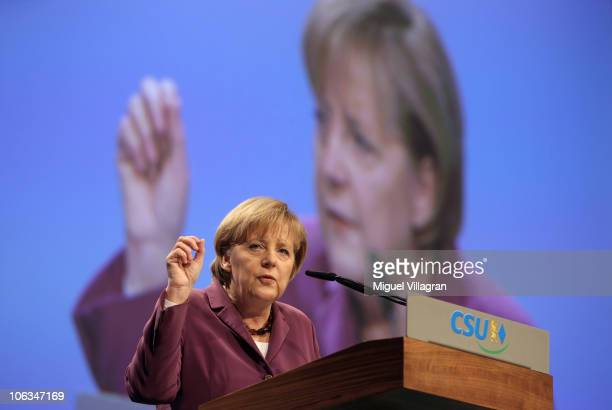 German Chancellor Angela Merkel addresses the audience during the CSU party convention at Messe Muenchen on October 29 2010 in Munich Germany The CSU...