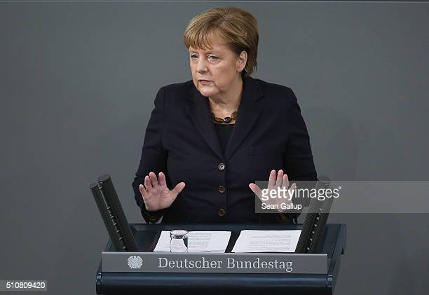German Chancellor Angela Merkel addresses the Bundestag in a government statement ahead of tomorrow's European Union summit in Brussels on February...