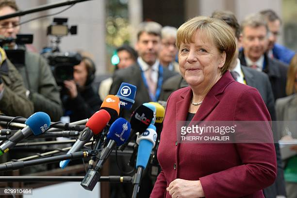 German Chancellor Angela Merkel addresses the media as she arrives for a European Union leaders summit focused on Russia sanctions and migration at...