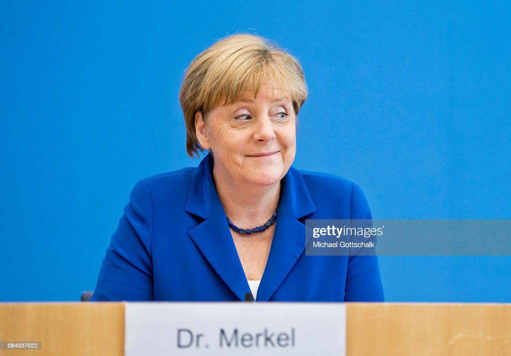 German Chancellor Angela Merkel addresses the media during her annual summer press conference in German Federal Press Conference or Bundespressekonferenz on July 28, 2016 in Berlin, Germany. Chancellor Angela Merkel said recent attacks involving asylum-seekers carried out in Germany would not change its willingness to take in refugees.