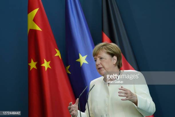 German Chancellor Angela Merkel, along with European Commission President Ursula von der Leyen and President of the European Council Charles Michel,...