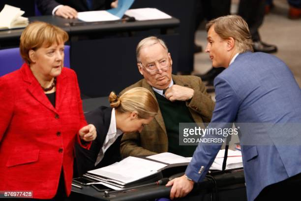 German Chancellor Angela Merkel also leader of the Christian Democratic Union walks past parliamentary group members of the farright AfD party as she...