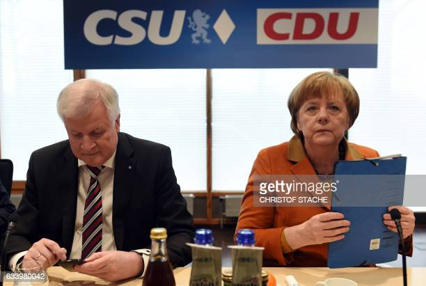 German Chancellor Angela Merkel also leader of the conservative Christian Democratic Union and Horst Seehofer chairman of the CDU's sister party the...