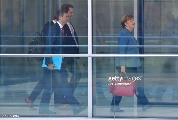 German Chancellor Angela Merkel also leader of the conservative Christian Democratic Union party is followed by German Transport Minister Alexander...