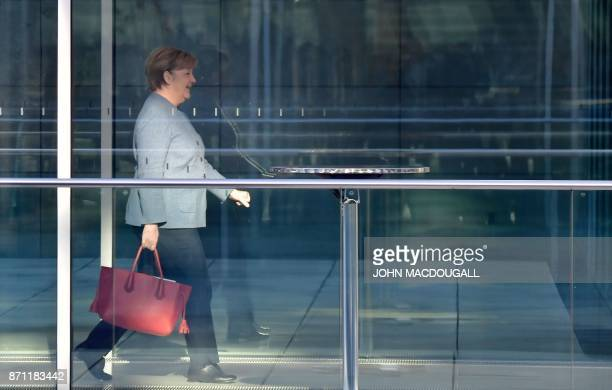 German Chancellor Angela Merkel also leader of the conservative Christian Democratic Union party walks to further exploratory talks with members of...