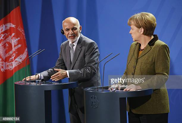 German Chancellor Angela Merkel and Afghan President Ashraf Ghani speak to the media following talks at the Chancellery on December 5 2014 in Berlin...
