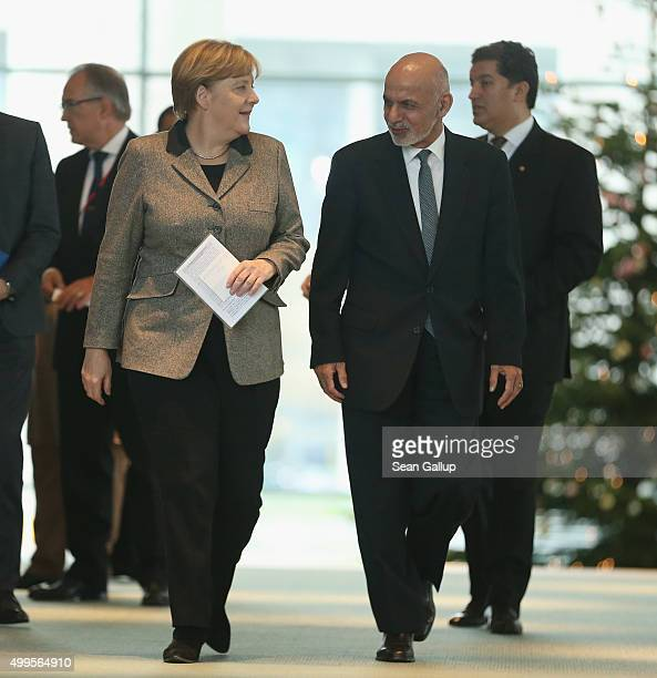 German Chancellor Angela Merkel and Afghan President Ashraf Ghani arrive to speak to the media following talks at the Chancellery on December 2 2015...