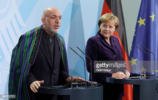 German Chancellor Angela Merkel and Afghan President Hamid Karzai speak to the media after talks at the Chancellery on January 27, 2010 in Berlin,...