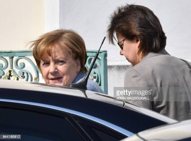 German Chancellor Angela Merkel and and her office manager Beate Baumann arrive for a meeting on April 10 2018 on the first day of the German...