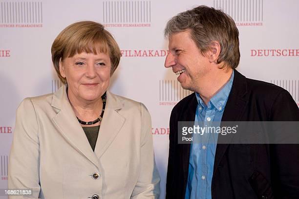 """German Chancellor Angela Merkel and Andreas Dresen attend the screening of the 1973 film """"Die Legende von Paul und Paula"""" at the Filmkunst 66 cinema..."""