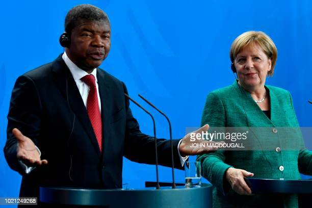 German Chancellor Angela Merkel and Angolan President Joao Lourenco attend a press conference after talks in the Chancellery in Berlin on August 22...