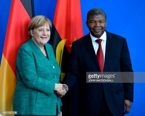 German Chancellor Angela Merkel and Angolan President Joao Lourenco shake hands after a press conference following talks in the Chancellery in Berlin...