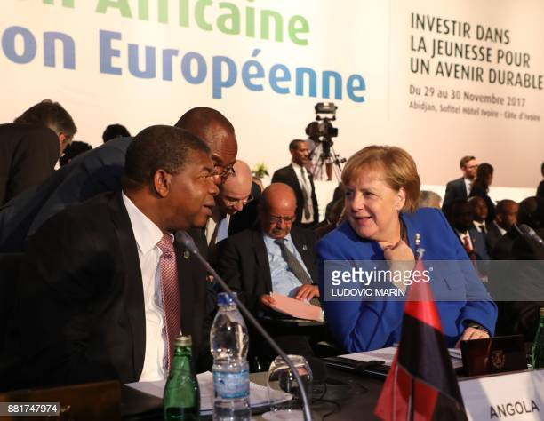 German Chancellor Angela Merkel and Angolan President Joao Lourenco speak as they attend the opening ceremony for The Africa EU Summit in Abidjan on...