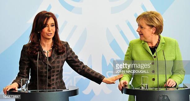 German Chancellor Angela Merkel and Argentina's President Cristina Fernandez de Kirchner address a press conference following talks at the...