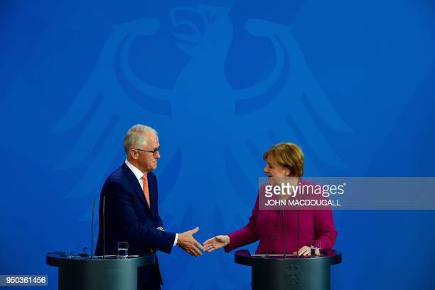 German Chancellor Angela Merkel and Australian Prime Minister Malcolm Turnbull shake hands after addressing journalists prior to their meeting at the...