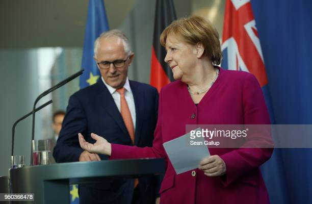 German Chancellor Angela Merkel and Australian Prime Minister Malcolm Turnbull arrive to speak to the media prior to talks at the Chancellery on...