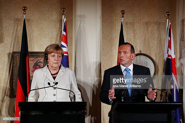 German Chancellor Angela Merkel and Australian Prime Minister Tony Abbott attend a press conference at Admiralty House on November 16 2014 in Sydney...