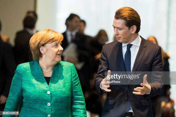 German Chancellor Angela Merkel and Austrian Chancellor Sebastian Kurz arrive to a press conference at the Chancellery in Berlin Germany on January...
