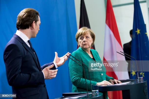 German Chancellor Angela Merkel and Austrian Chancellor Sebastian Kurz are pictured during a press conference at the Chancellery in Berlin Germany on...