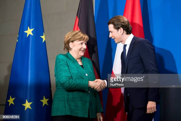 German Chancellor Angela Merkel and Austrian Chancellor Sebastian Kurz shake hands at the end of a press conference at the Chancellery in Berlin...