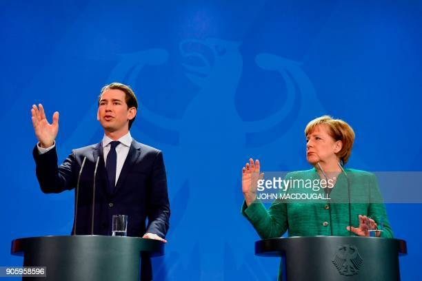 German Chancellor Angela Merkel and Austria's new Chancellor Sebastian Kurz give a joint press conference at the Chancellery in Berlin on January 17...