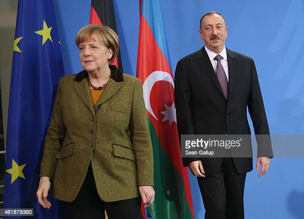 German Chancellor Angela Merkel and Azerbaijani President Ilham Aliyev depart after speaking to the media following talks at the Chancellery on...