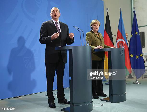 German Chancellor Angela Merkel and Azerbaijani President Ilham Aliyev depart speak to the media following talks at the Chancellery on January 21...