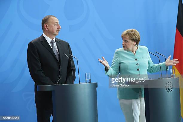 German Chancellor Angela Merkel and Azerbaijani President Ilham Aliyev speak to the media following talks at the Chancellery on June 7 2016 in Berlin...