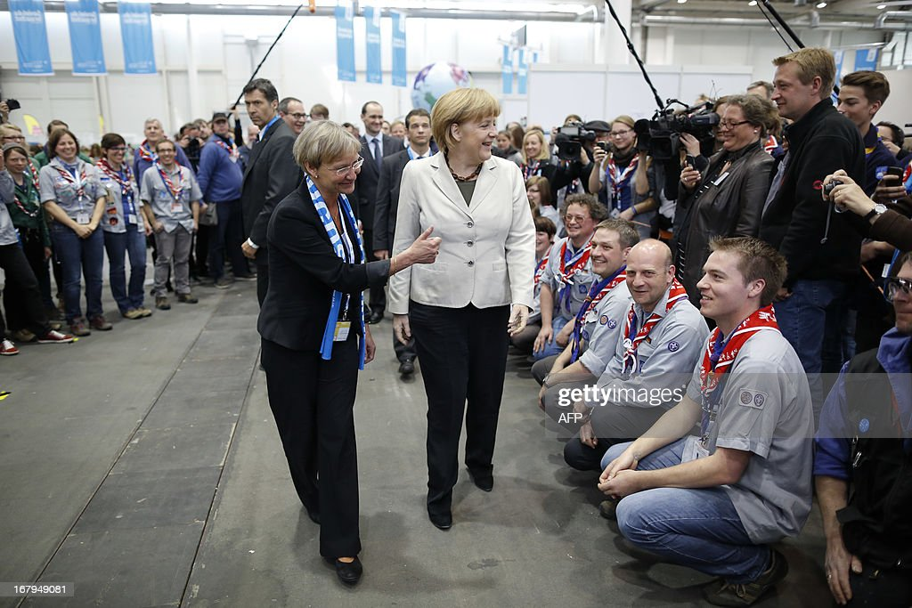 German chancellor angela merkel c and bishop kirsten fehrs l german chancellor angela merkel c and bishop kirsten fehrs l greet scout m4hsunfo