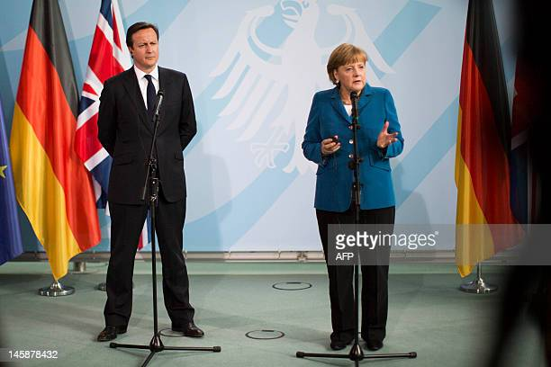 German Chancellor Angela Merkel and British Prime Minister David Cameron address a press conference at the chancellery in Berlin on June 7, 2012....