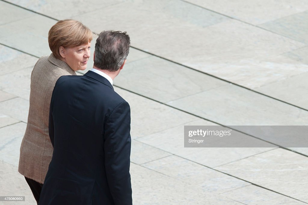 German Chancellor Angela Merkel and British Prime Minister David Cameron review a guard of honour upon Cameron's arrival at the Chancellery on May 29, 2015 in Berlin, Germany. Cameron is in Berlin as part of his tour of European Union member states capitals in order to persuade leaders on the necessity of E.U. reforms.