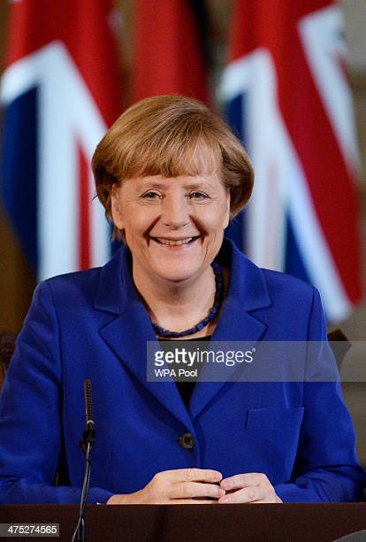 German Chancellor Angela Merkel and British Prime Minister David Cameron attend a joint press conference at 10 Downing Street on February 27 2014 in...