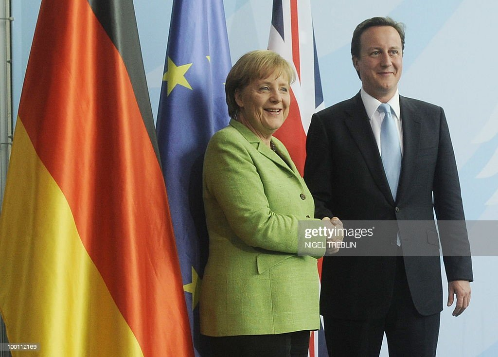 German Chancellor Angela Merkel and British Prime Minister David Cameron shake hands after addressing a press conference at the Chancellery in Berlin on May 21, 2010. Cameron is on his first visit to Germany since becoming prime minister.