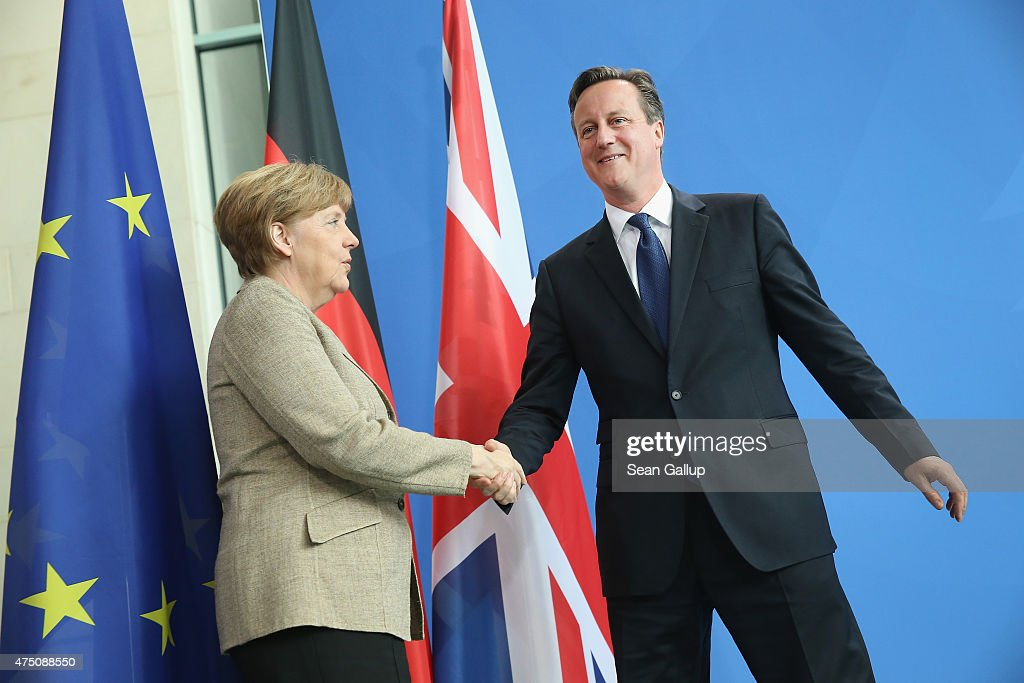 German Chancellor Angela Merkel and British Prime Minister David Cameron departs after speaking to the media following talks at the Chancellery on May 29, 2015 in Berlin, Germany. Cameron is in Berlin as part of his tour of European Union member states capitals in order to persuade leaders on the necessity of E.U. reforms.